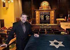 Rabbi Victor Urecki stands in the B'nai Jacob Synagogue
