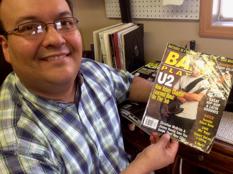 Roger Morillo and one of many bass magazines to feature his instruments.