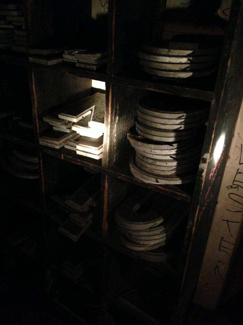 Sets of marquee lettering sit stack in the theater's basement collecting dust.