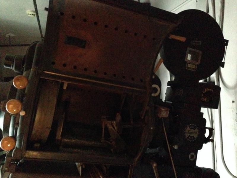 Two projectors still sit in the old projection room above the theater.