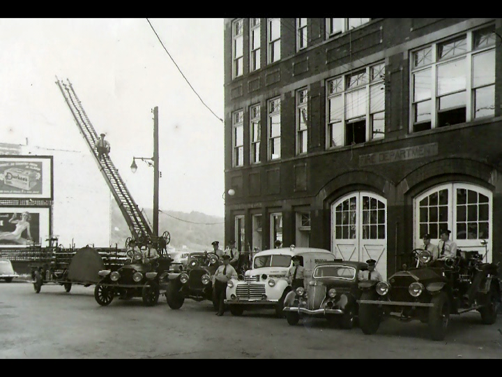 Vintage photo of firemen and fire response vehicles in front of Firehouse on Monroe Street in Fairmont