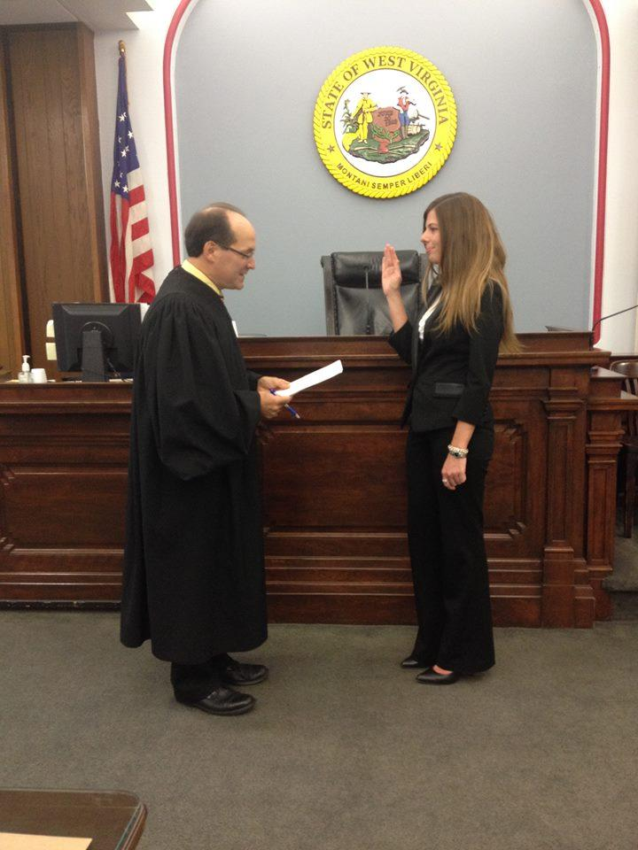 Marion County Circuit Court Judge Michael Aloi swears in a CASA Volunteer
