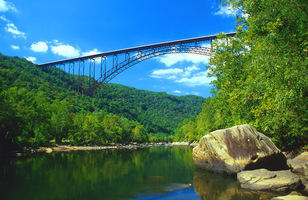 Its 1,700-foot arch made it the longest single-span arch bridge in the world.