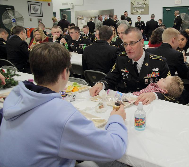 Staff Sgt. William Johnson and his family share a meal during the December drill weekend and annual Christmas party for the U.S. Army Reserve's 363rd Military Police Company.
