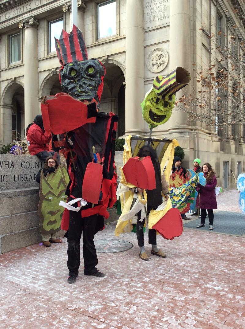 Puppets representing the coal companies (left) and Freedom Industries (right).