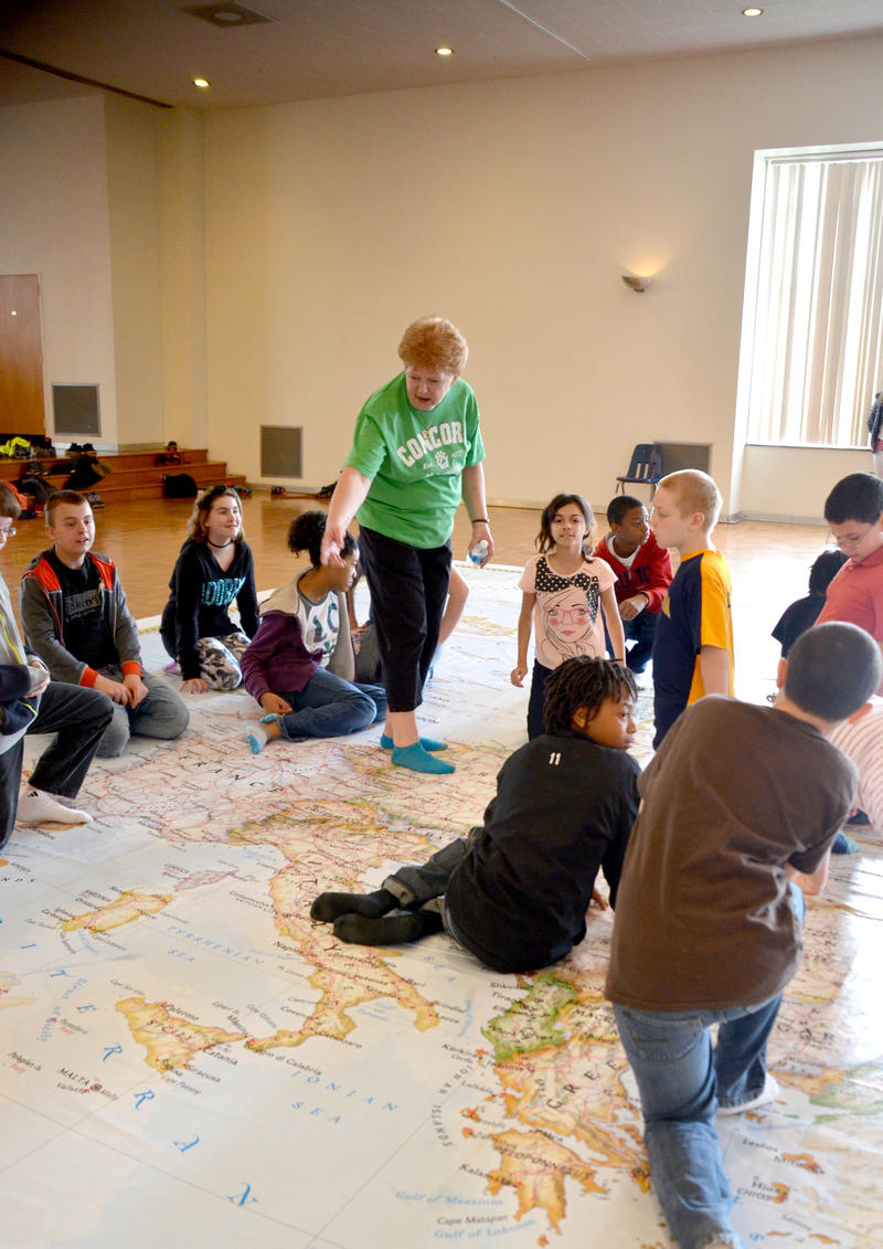 Linda Poff takes fifth graders from Bluefield Intermediate School on a tour of Europe on National Geographic's Giant Traveling Map during its visit to Concord University. A graduate of Concord, Poff is a retired Mercer County school teacher and coordinato