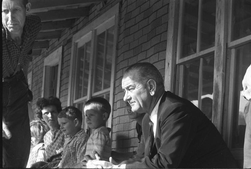 President Lyndon B. Johnson visit to Tom Fletcher residence during Poverty Tour of Appalachia.