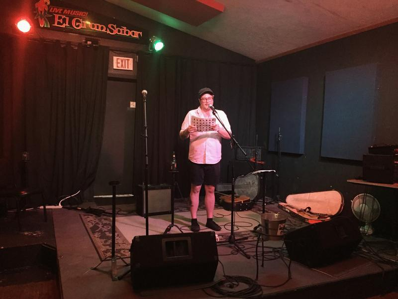 Writer Howard Parsons reads a short story during the opening night of the Tales of Tribulations and Turpitude tour in Elkins.