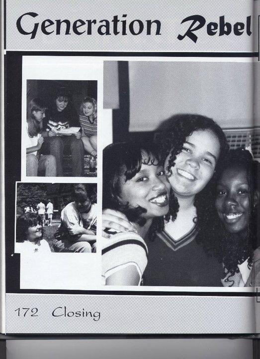 Angels Asbury (far right) poses for the camera with friends. This picture was taken while Angela attended Mullens High School.