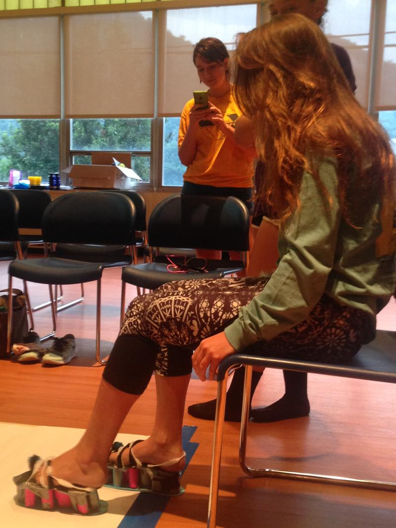 A camper prepares to test her paper shoes during the biomechanical competition.