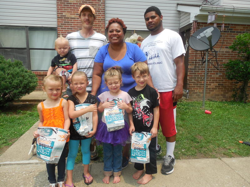 Ryan Turner's three children, Carson, Makayla and Zayla, line up to get lunch, with their neighbors Destiny and Austin. Renieca Harris and her son Brandon deliver the food for Perry County's new Summer Meals Program.