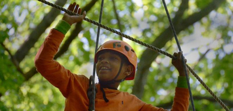 Child on high ropes