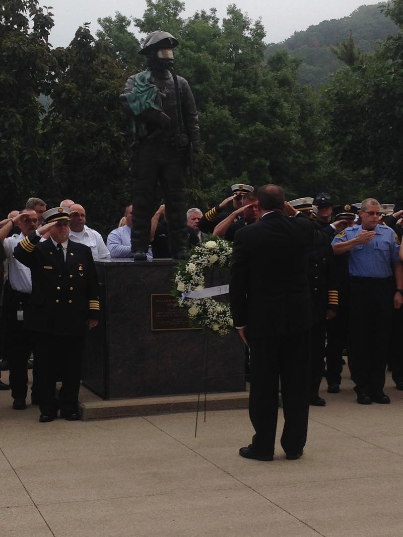 Gov. Tomblin lays a wreath at the Fallen Firefighter Memorial at the West Virginia Capitol.