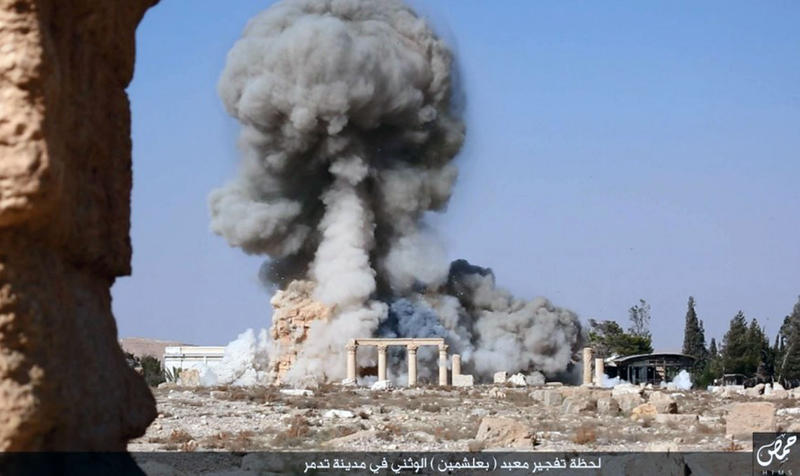 In this undated photo released Tuesday, Aug. 25, 2015, on a social media site used by Islamic State militants, shows smoke from the detonation of the 2,000-year-old temple of Baalshamin in in Syria's ancient caravan city of Palmyra.