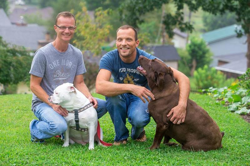 Burley and Sam Williams with their dogs, Gracie and Bella
