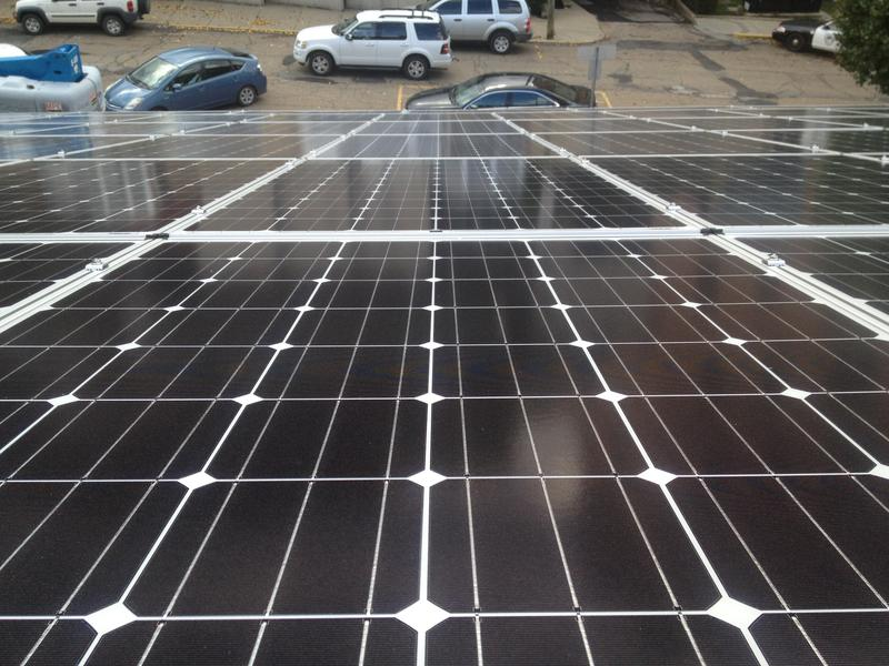 solar panels atop the garage attached to the First State Capitol Building