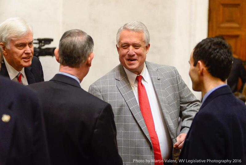 Senate President Bill Cole speaking with fellow Sentors before a recent floor session.