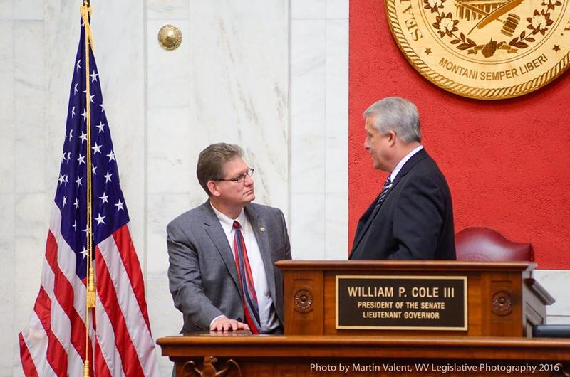 Senate Education Chair Deve Sypolt speaking with Senate President Bill Cole before a floor session.