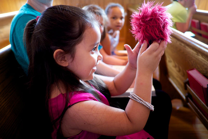 Lilly, a member of the kids' church congregation at Cedar Grove United Methodist Church, examines a sound recorder