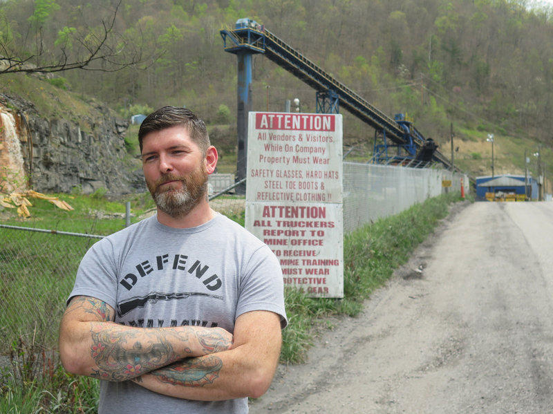 Gary Bentley stands outside a Letcher County, Ky., coal mine where he worked before he was laid off in 2012