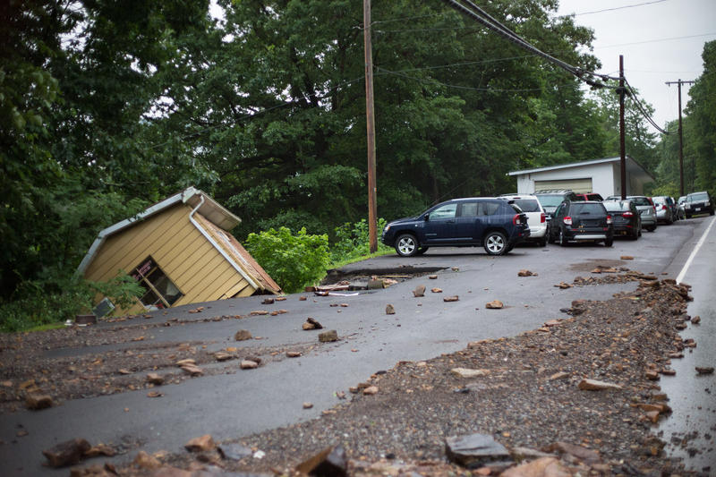 Heavy rains cause the ground to collapse underneath the Main Street Motors office building in Richwood, WV.