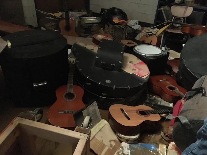 Acoustic guitars strewn across the floor of the Herbert Hoover High School band room which reportedly took on 7 and a half feet of flood water.