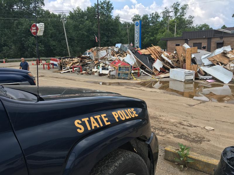 A State Police cruiser sits next to the site where the Clendenin Dairy Queen once stood. The collasped store has yet to be cleared.