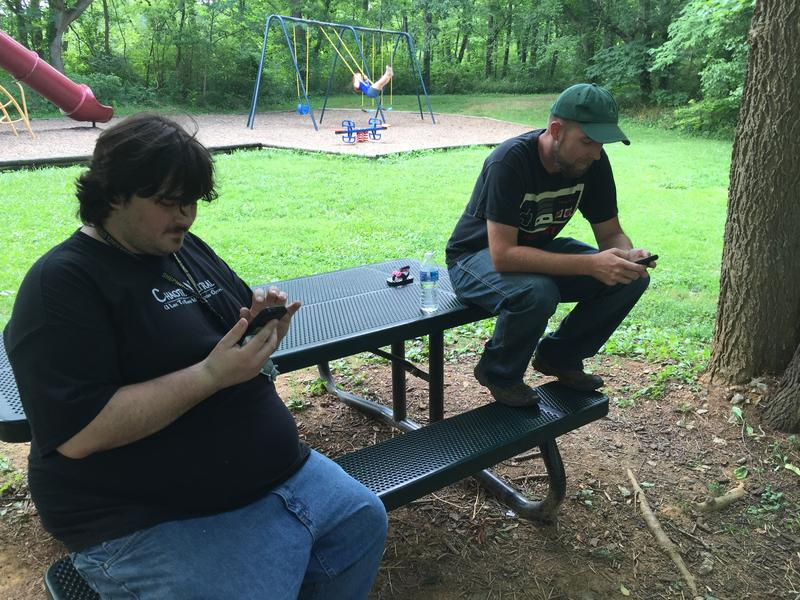 Dylan Meushaw (left) and Russell Thomas (right) search for nearby Pokémon.