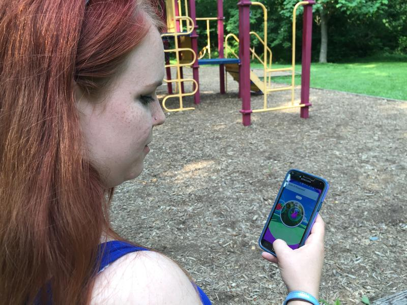 Rebeccah Mathias spins a PokéSpot for in-game items.