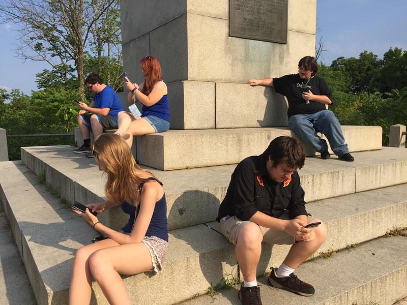 Friends gather at the Rumsey Monument in Shepherdstown to play Pokémon GO.