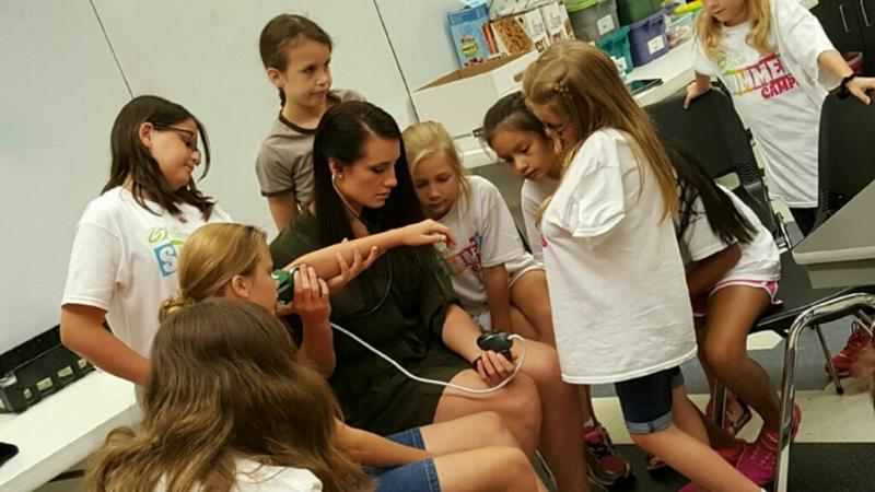 Campers learn how to take blood pressures.
