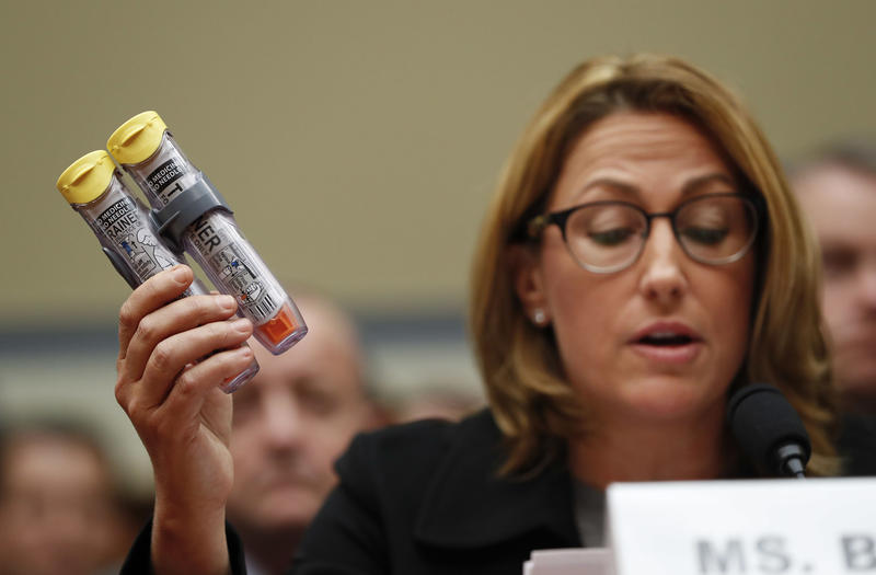 Mylan CEO Heather Bresch holds up an EpiPen while testifying on Capitol Hill in Washington, Wednesday, Sept. 21, 2016, before the House Oversight Committee hearing on EpiPen price increases.