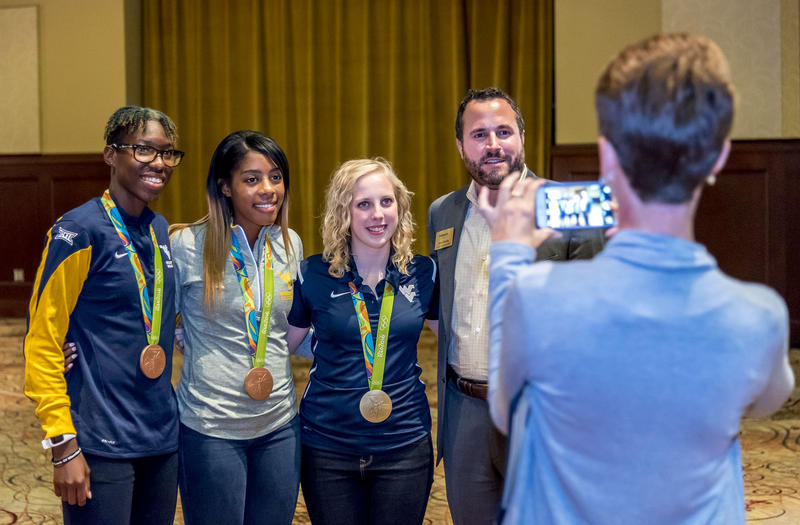 Olympic medalists and WVU students Kadeisha Buchanan, Ashley Lawrence and Ginny Thrasher pose for a photo Monday, Sept. 26, at the Morgantown Event Center.