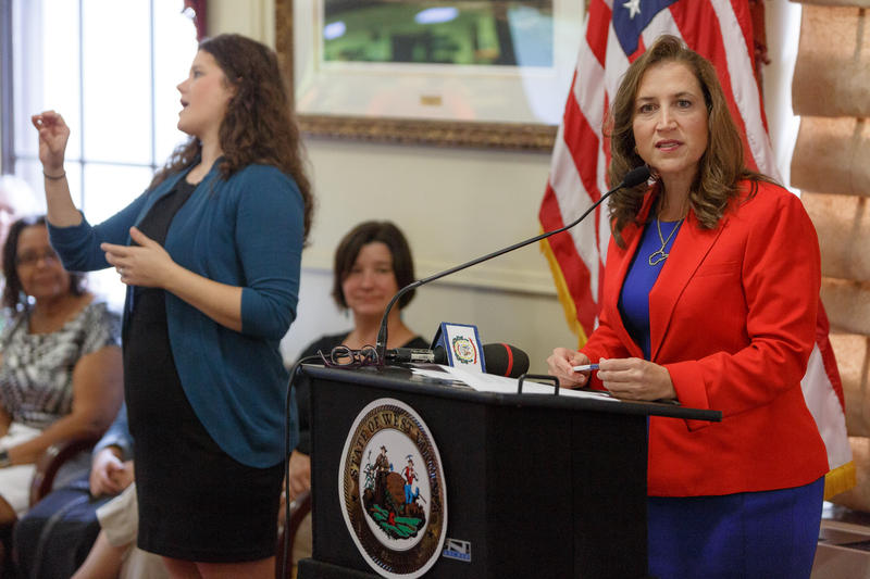 Secretary of State Natalie Tennant, right, during a press conference at the state Capitol Thursday.