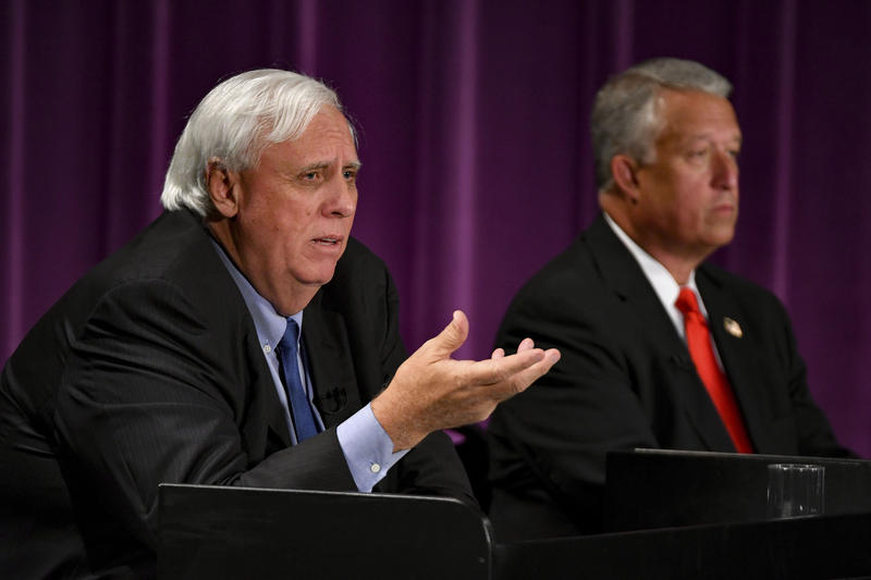 Billionaire businessman Jim Justice, left, and Senate President Bill Cole, right, in their first debate last week.