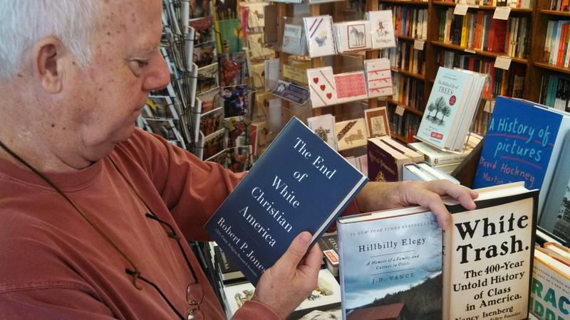 Carmichael's Books co-owner Michael Boggs with some of the recent books on the condition of the white working class.