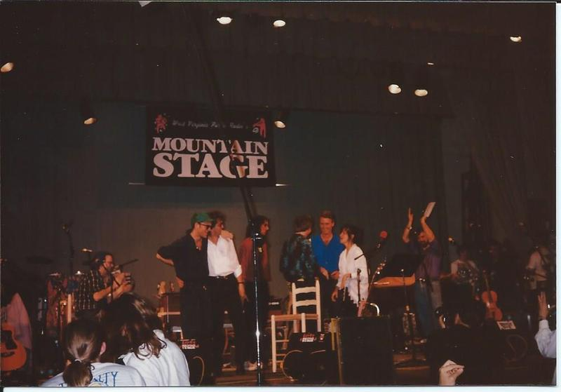 R.E.M. being presented the R.E.M. Day proclomation by then-Governor Gaston Caperton, his first-lady Rachel Warby, and Mountain Stage host Larry Groce.