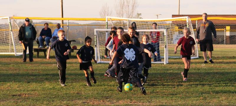 McDowell County elementary students playing a soccer match