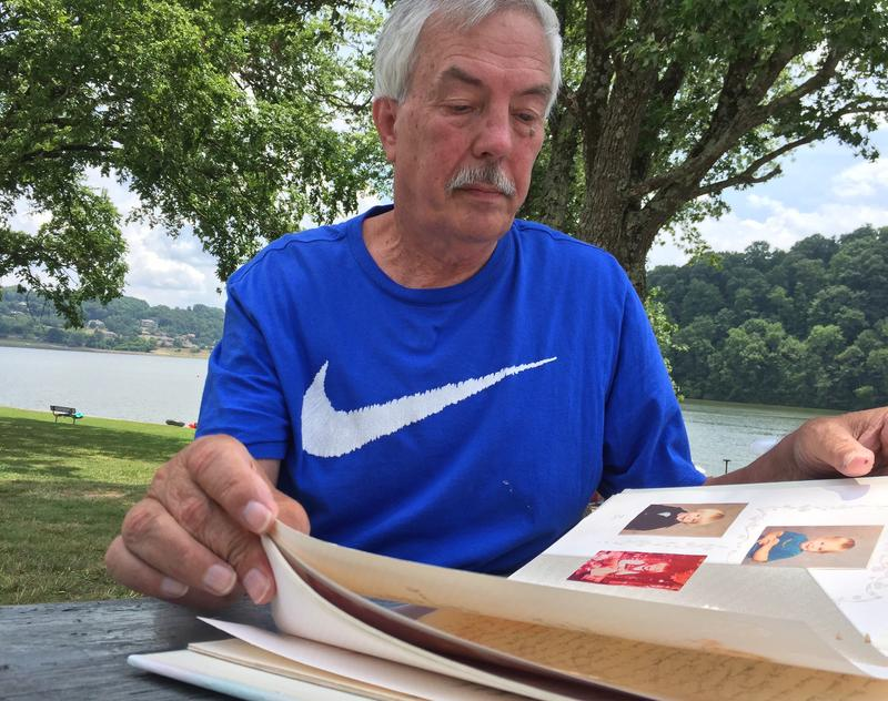Vince Brown of Oliver Springs, Tenn., looks at photos of his son Michael Brown, who became addicted to prescription painkillers after an injury ended his baseball career.
