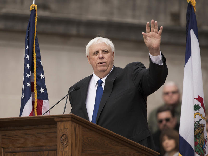 West Virginia Gov. Jim Justice waves to the crowd as he delivers his inauguration speech, Monday, Jan. 16, 2017, in Charleston, W.Va.