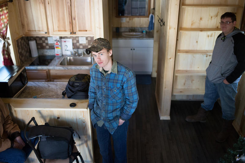 A student stands in one of the Tiny Homes during a demonstration in December.