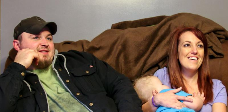 Coal miner Jonathan Griffith sits with his wife, Jessica Griffith while she holds Rowan. The family lives in Wyoming County, West Virginia.
