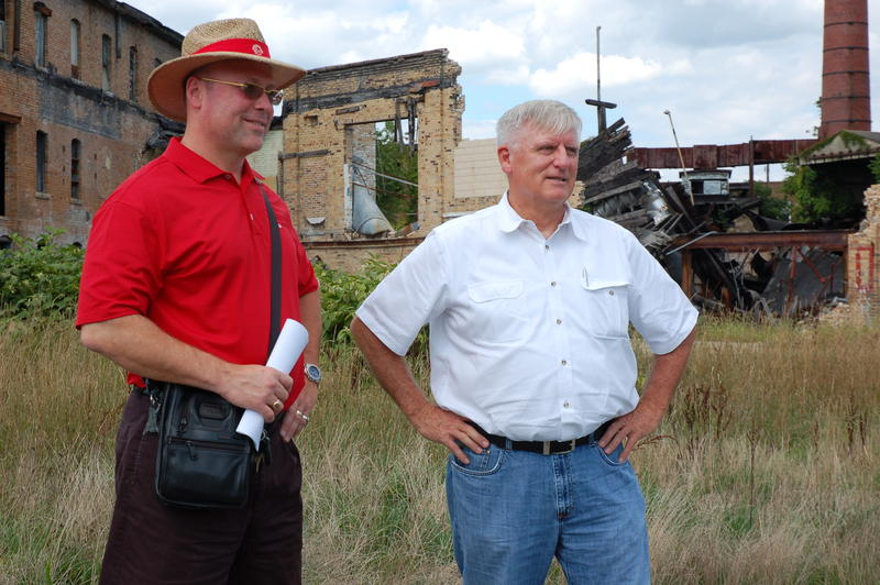Patrick Ford (in red) and Assistant Director Marvin Six of the Brooke-Hancock Business Development Corporation at the abandoned and contaminated pottery plant in 2012.