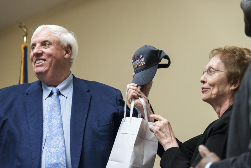 West Virginia Gov. Jim Justice accepts a ball cap from Fairmont State University President Maria Rose after giving a speech during a stop on his Save Our State Tour on Thursday, March 3, 2017, at FSU.