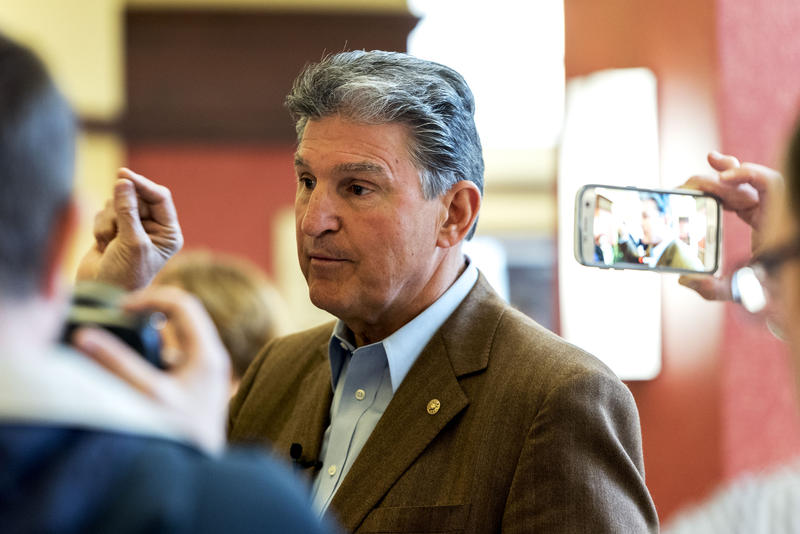 Sen. Joe Manchin takes questions from reporters before the town hall meeting.