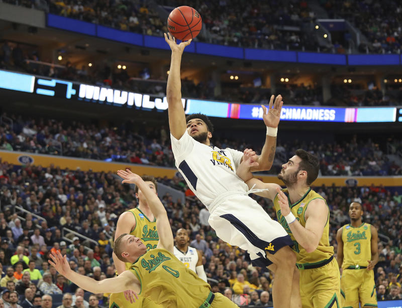 West Virginia forward Esa Ahmad (23) goes to the basket against Notre Dame guard Rex Pflueger (0) and guard Matt Farrell (5) during the first half of a second-round men's college basketball game in the NCAA Tournament, Saturday, March 18, 2017, in Buffalo