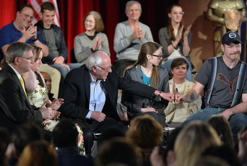 U.S. Sen. Bernie Sanders, I-Vt., fist bumps McDowell County miner Phillip Lucion during Sunday's town hall meeting at Mount View High School, in Welch, where Sanders discussed infrastructure, mining and health care with multiple panels.