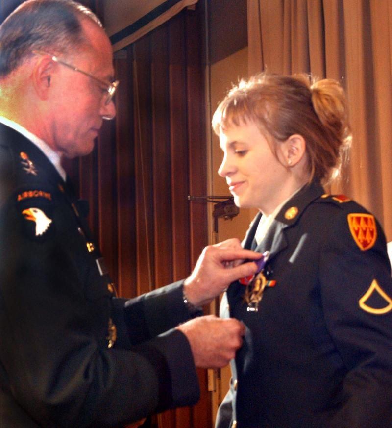 Pfc. Jessica Lynch receives the Purple Heart from Lt. Gen. James B. Peake, U.S. Army surgeon general, during a ceremony at Walter Reed Army Medical Center on July 21, 2003. Lynch also received the Bronze Star and the Prisoner of War Medal.