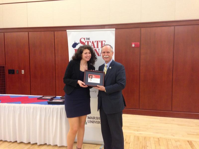 Joni Deutsch receives the Generation Next: 40 Under 40 award from Congressman David McKinley.