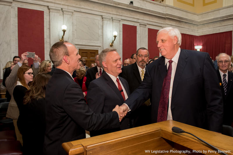 Governor Jim Justice shakes hands with Senate President Mitch Carmichael (left) and House Speaker Tim Armstead at the State of the State address,